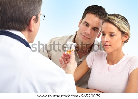 Medical doctor and young couple patients. Over blue background - stock photo
