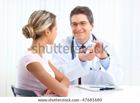 Medical doctor and young woman patient.