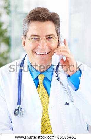 Medical doctor calling by phone in the office - stock photo