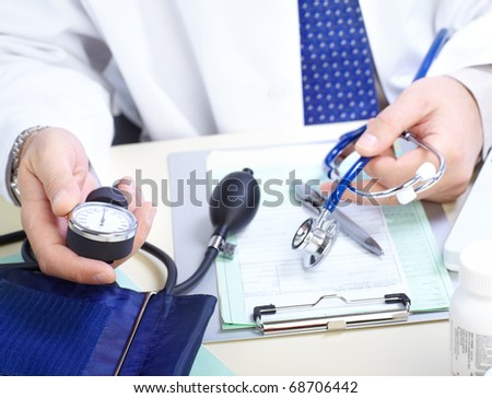 Medical doctor holding a blood presure sphygmomanometer with stethoscope