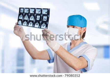 medical doctor looking at CT computer tomography scan image in hospital - stock photo