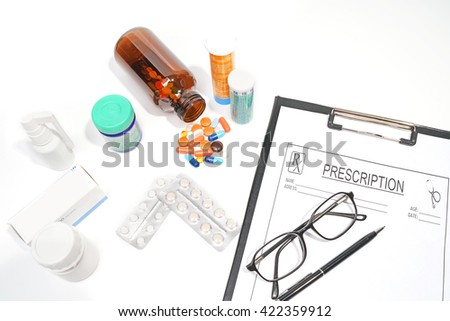 Medical doctor.medicine,bottle ,prescription,glasses,pen,isolated on the white background. - stock photo