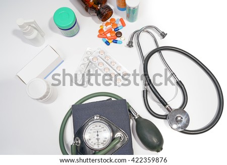 Medical doctor.medicine,bottle ,vintage sphygmomanometer ,stethoscope isolated on the white background. - stock photo