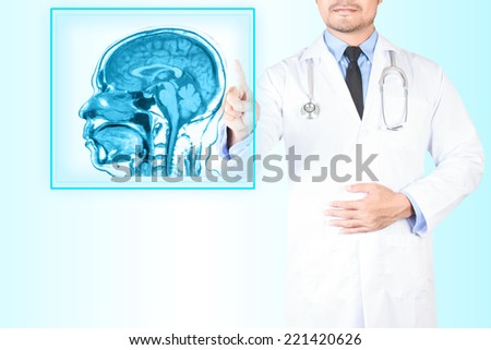 Medical doctor pointing magnetic resonance of human brain scan on virtual screen for diagnose - stock photo