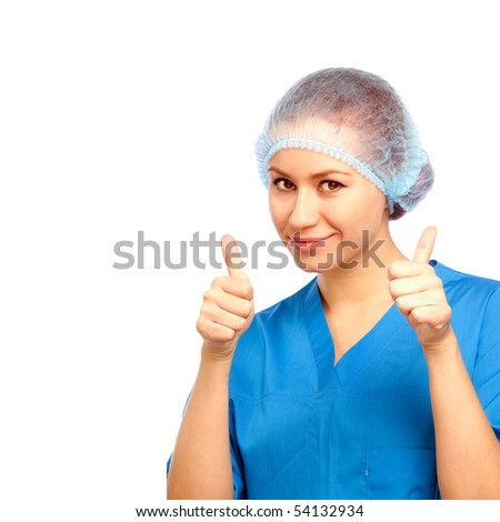 Medical doctor shows two thumbs up and smile. On over white
