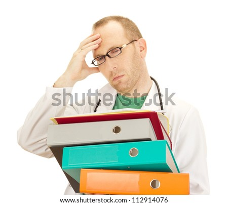 Medical doctor with a lot of work - stock photo