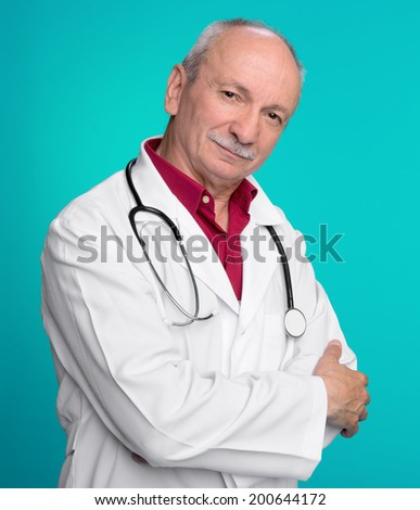 Medical doctor with stethoscope on a blue background - stock photo