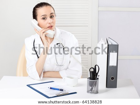 medical doctor with telephone in the office - stock photo