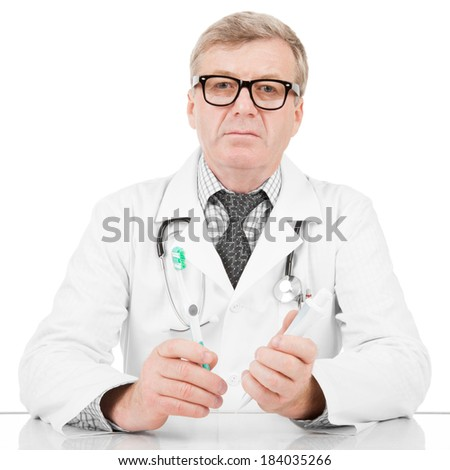 Medical doctor with tooth paste and tooth brush in hands - 1 to 1 ratio