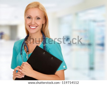 Medical doctor woman in the hospital - stock photo