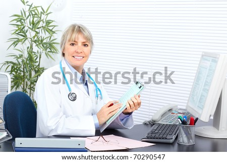 Medical doctor woman in the office - stock photo