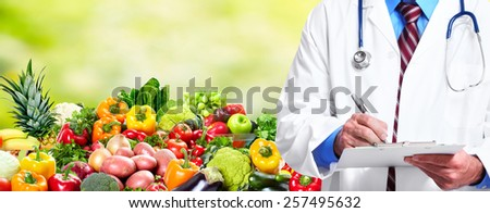 Medical doctor woman over Diet and health care background. - stock photo