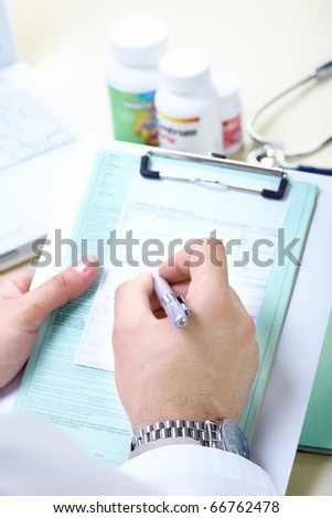 Medical doctor working in the office - stock photo