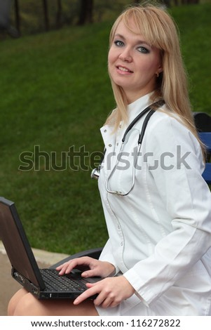 Medical doctor working with laptop. - stock photo
