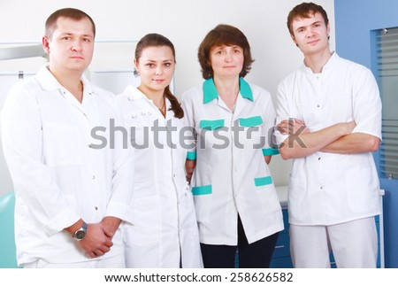 Medical doctors standing in office - stock photo