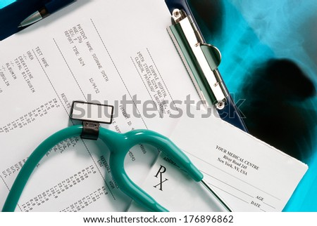 Medical documents (blood test and prescription) with a stethoscope on Xray photo of lungs