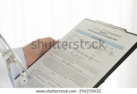 Medical documents in hand doctors on a white background. - stock photo