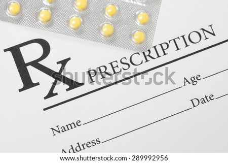 Medical drug prescription and pills over it - studio shot - stock photo