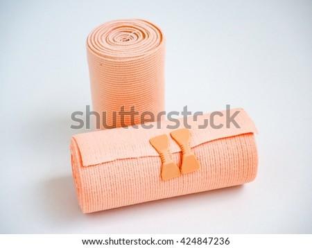 Medical elastic tensor bandage on white background - stock photo