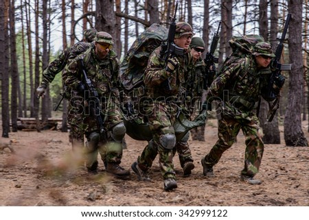 Medical evacuation of wounded soldier - stock photo