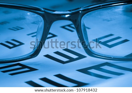 medical eye chart and glasses - stock photo