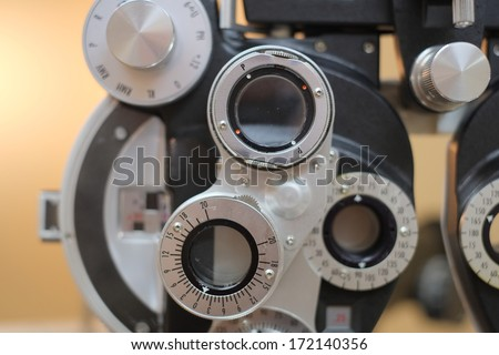 Medical eye optometrist equipment used for medical eye exams - stock photo