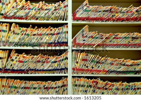 Medical files with patient information in doctor's office - stock photo