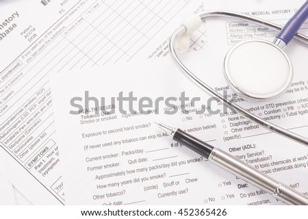Medical Form and stethoscope - stock photo