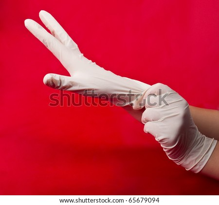 medical gloves on red background - stock photo