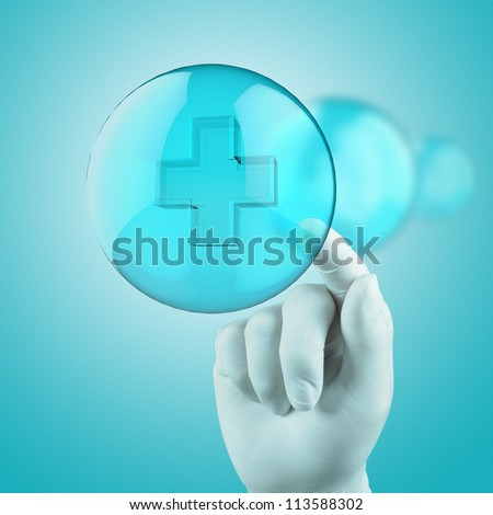 medical hand with globe select on first aid sign - stock photo