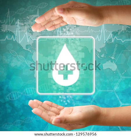 Medical icon Donate blood,Blood Drop in hand - stock photo