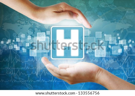 medical icon, Hospital symbol in hand - stock photo