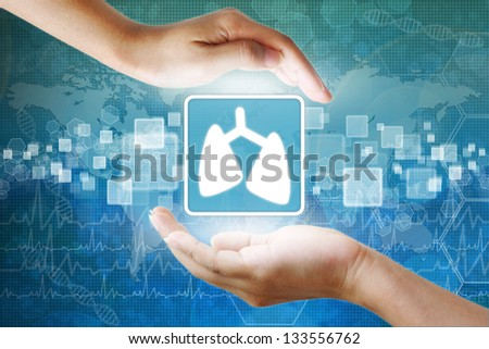medical icon, Lung symbol in hand - stock photo
