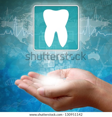 Medical icon Tooth in hand - stock photo