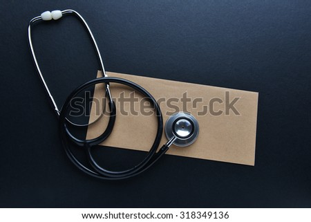 Medical idea conceptual with envelope and stethoscope. Insurance or business concept