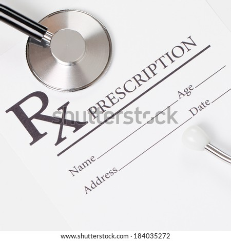 Medical ideas - blank prescription and stethoscope - 1 to 1 ratio - stock photo