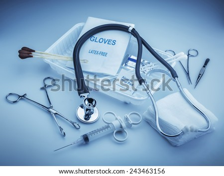 Medical instruments for ENT doctor on pale blue - stock photo