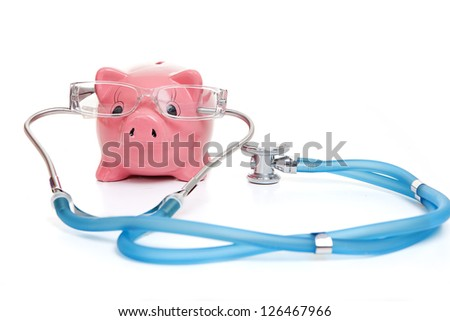 medical insurance concept with stethoscope money and glasses - stock photo