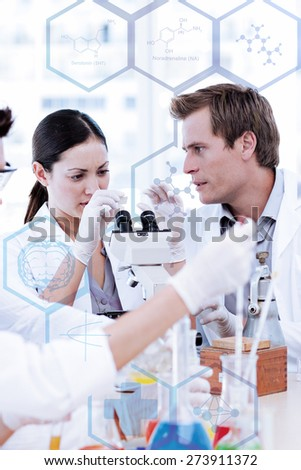 Medical interface against scientists working in a laboratory - stock photo