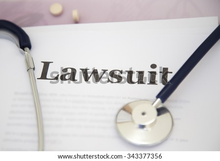 Medical Malpractice Paperwork Lawsuit Papers On Desk Of A Doctor - stock photo
