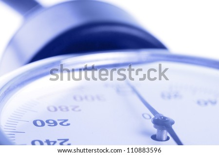 Medical manometer closeup with selective focus on 260 figure as concept of high blood pressure - stock photo