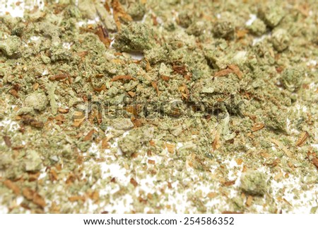Medical Marijuana and Cannabis Bud on White  - stock photo