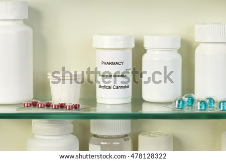 Medical marijuana container on medicine cabinet shelf. Labels are fictitious and created by the photographer.