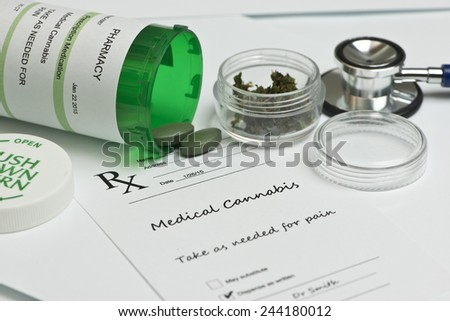 Medical marijuana prescription with bottle and stethoscope. - stock photo