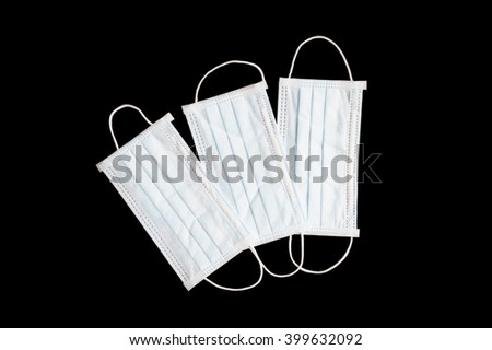 medical mask on black background - stock photo