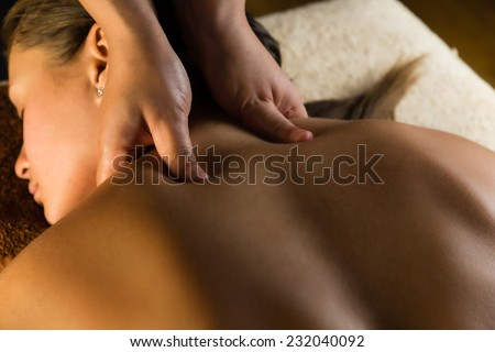Medical massage close up. Beautiful tranquil lighting - stock photo