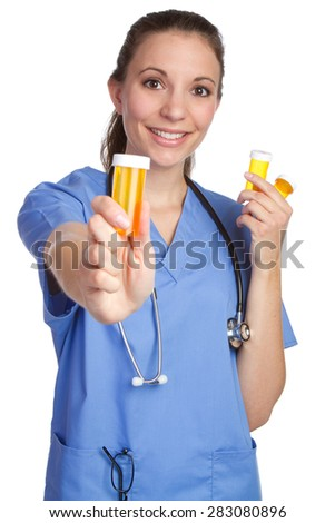 Medical nurse holding pills bottle - stock photo