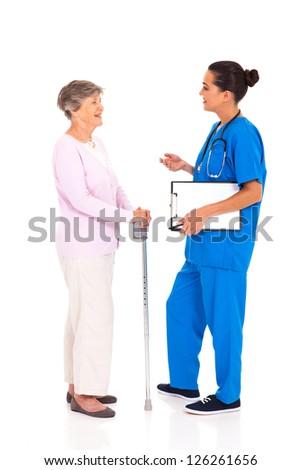 medical nurse talking to senior woman isolated on white - stock photo