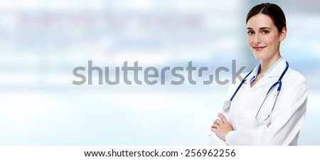 Medical physician doctor  woman over blue clinic background. - stock photo