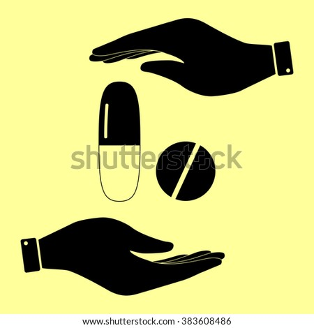 Medical pills sign. Save or protect symbol by hands. - stock photo